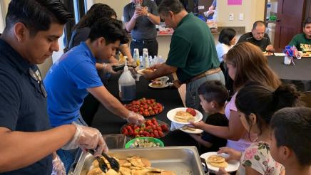 Team Medina and Team TODEC serve pancakes to constituents
